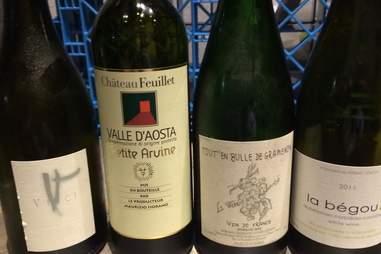 Row of wine bottles at Vino