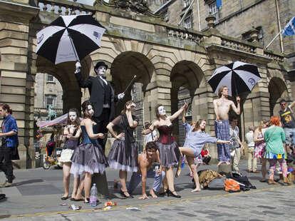 Fringe Festival performers on the Royal Mile in Edinburgh, Scotland, United Kingdom