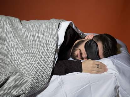 Man sleeping with eye mask