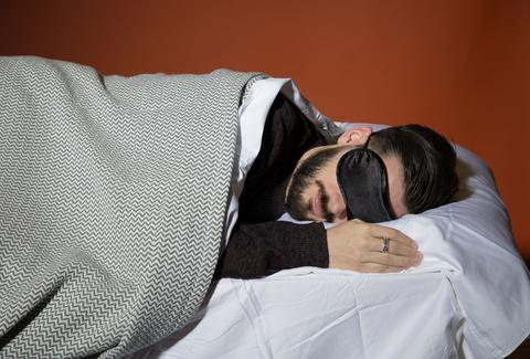 Man sleeping with eye mask