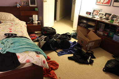 Messy bedroom with clothes strewn about