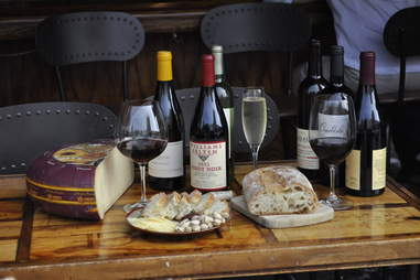 Cheese, bread, and wine at California Wine Merchant bar in Marina, San Francisco, California