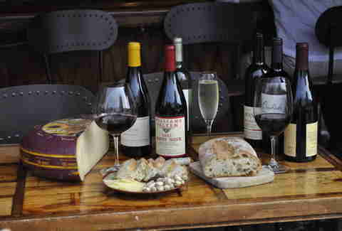 Cheese, bread, and wine at California Wine Merchant bar in Marina, San Francisco, California
