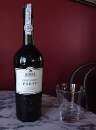 Bottle of fine white porto with glass