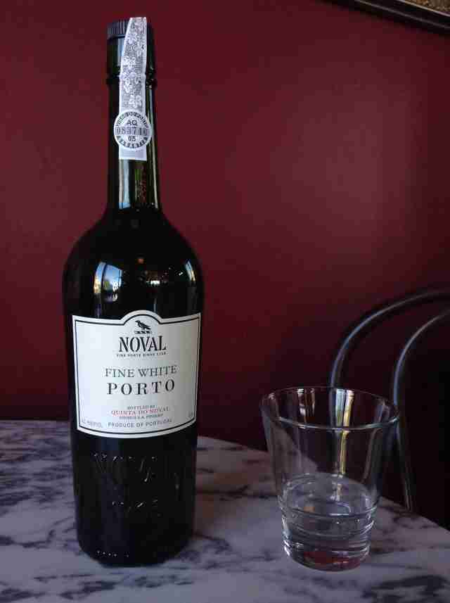Bottle of fine white porto with glass