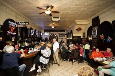 patrons at Schaller's Pump Bar in Chicago