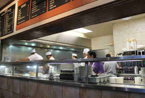 workers behind counter making breakfast at Valois in Chicago