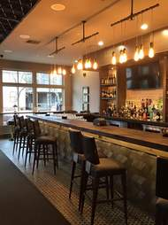 Softly lit interior of Vida wine bar