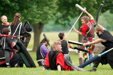 People LARPing and role playing  with foam weapons