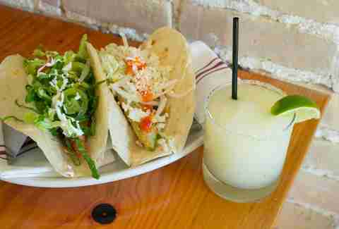 tacos with lettuce, cheese and jalapenos and a frozen margarita at Benji's Cantina