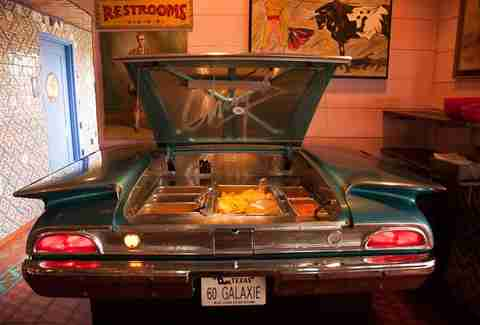 hot nachos served out of a classic car at Chuy's