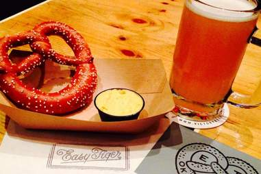 large soft pretzel with salt, cheese and a pint of beer at Easy Tiger Bakeshop and Beer