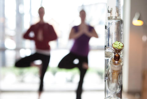 Two people doing yoga and meditating with a bong and weed/marijuana