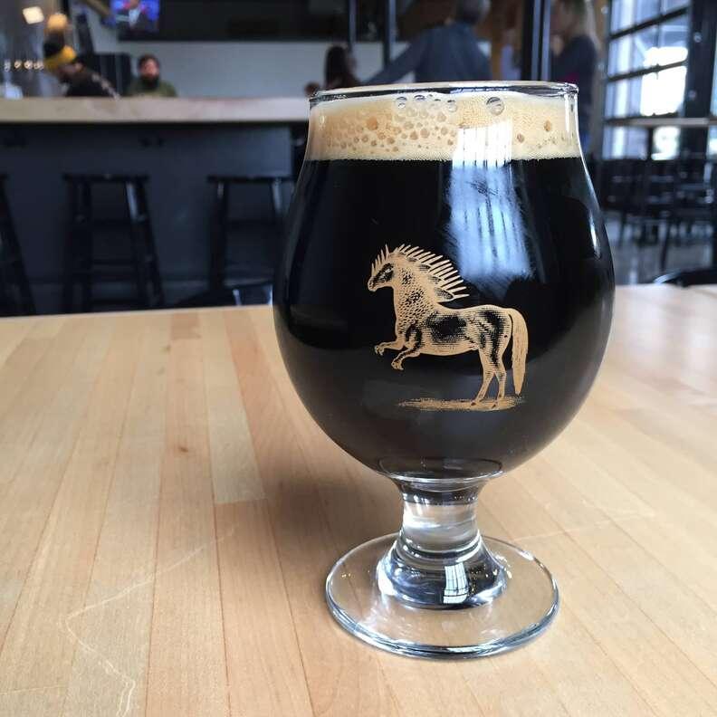 dark beer in a glass at Ponysaurus Brewing