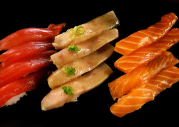 Salmon and tuna sushi laid in a row