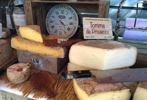 French cheeses set outside with butcher's knife