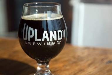 dark beer in a glass from upland brewing co