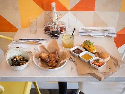 umami fried chicken, braised kale, biscuits, grilled corn and whiskey at The Peached Tortilla