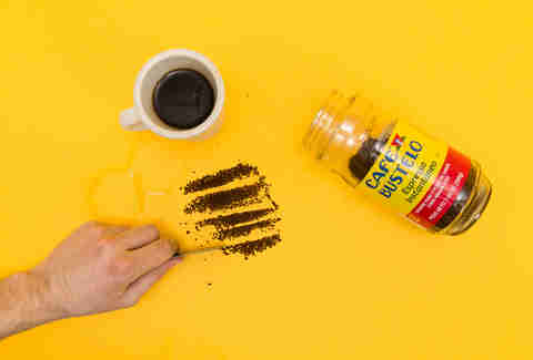 Hand cutting lines of coffee, Cafe Bustelo instant coffee