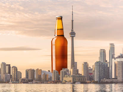 beer bottle imposed on skyline