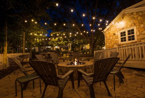 patio with chairs and fire pit at Vin 25 wine bar