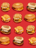 All 20 McDonald's breakfast sandwiches on red background