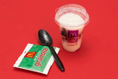 McDonald's yogurt parfait with granola and plastic spoon
