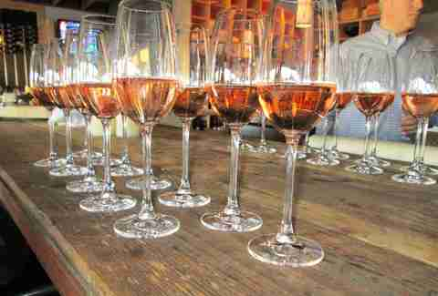 tasting glasses of rose wine at vino venue