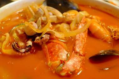 spicy broth with seafood, mussels, crab
