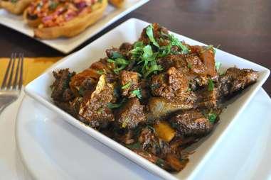 Pradesh-style goat pepper fry wirh meat and gravy at Paradise Biryani