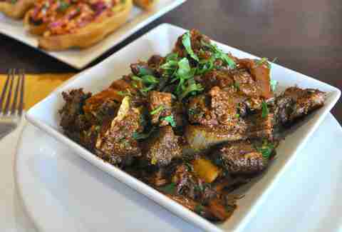 Pradesh-style goat pepper fry wirh meat and gravy at Paradise Biryani