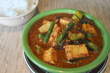 Thai hot green curry with tofu, eggplant, green beans at US Thai
