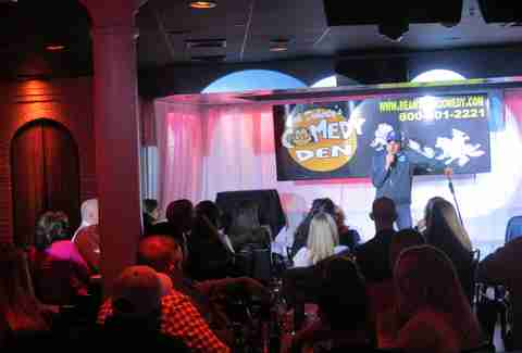 Comic performing to a full house at Dick Doherty's Comedy Den