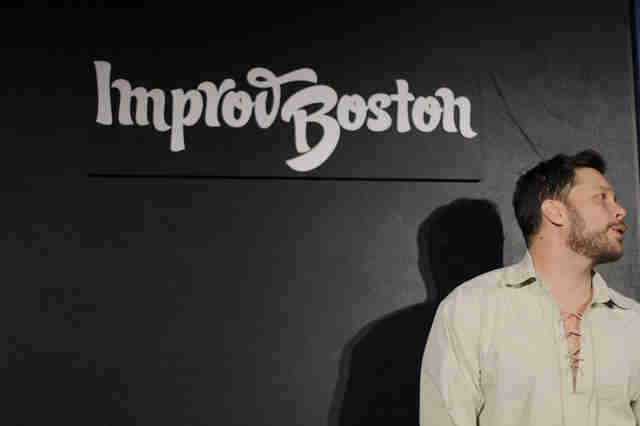 Comic speaking at ImprovBoston stage