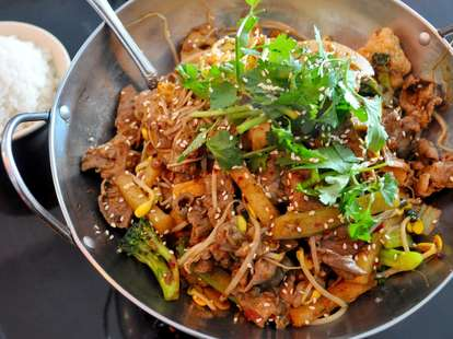 spicy Asian dish with sesame seeds, noodles and broccoli at YumYumSpice
