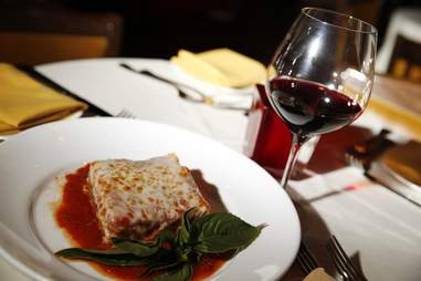 Eggplant parmigiana and wine at Ferraro's Italian restaurant and wine in Eastside, Las Vegas, Nevada