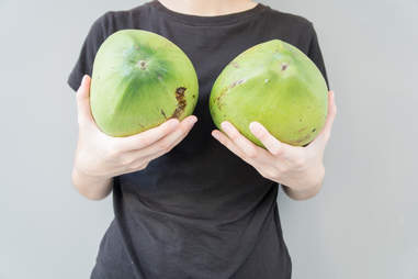 Woman holding watermelons in front of chest