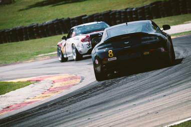 An Aston Martin Vantage on a race track
