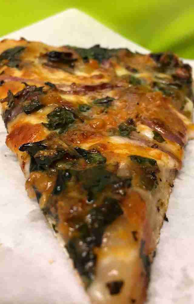Close-up of slice of Arizmendi pizza