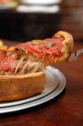 Slice of red deep dish pizza at Patxis