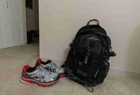gym backpack and sneakers near a doorway