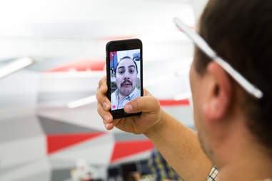 man using snapchat on an iPhone