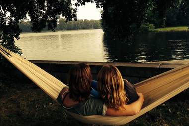 Couple overlooking Amsterdam lake from a hammock