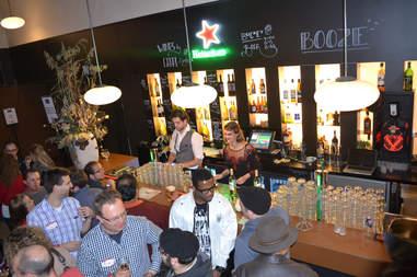 Packed Jordaan bar with bartenders