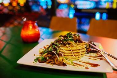 Dish of food on green table at TonTon Club