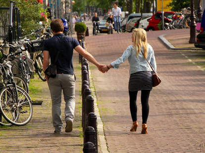 Couple strolling while on a European vacation