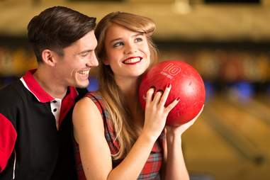 Young couple at bowling alley
