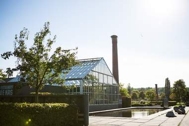 Exterior shot of De Kas' greenhouse space