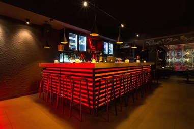 Neon lit bar counter at Ginger Grill & Asian Tapas