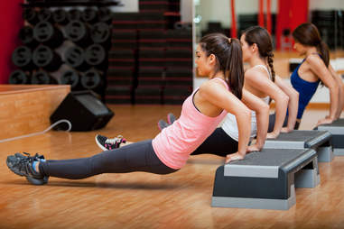 women in group fitness class, triceps